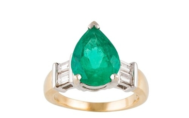 AN EMERALD AND DIAMOND RING, the pear shaped emerald to bagu...