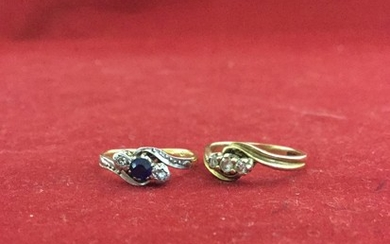 An 18ct gold ring, set with a diamond and sapphire twist and...