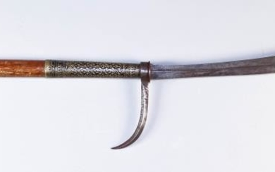An Indo-Persian Polearm, the wood shaft with brass terminal...
