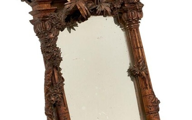 An Italian carved walnut table mirror, mid 19th century, of...