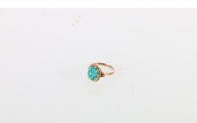 Antique yellow metal ring set with oval cabochon turquoise s...