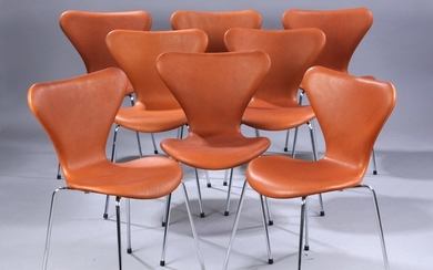Arne Jacobsen. A set of eight 'Series 7' chairs, Model 3107, cognac-coloured aniline leather, new seat height 46.5 cm (8)