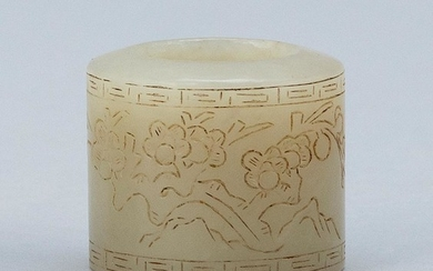 "CHINESE CELADON GREEN JADE THUMB RING Cylindrical, with prunus and calligraphy design. Height 1.2""."