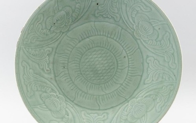 """CHINESE CELADON PORCELAIN CHARGER Central incised floral medallion surrounded by a wide lotus flower border. Height 2"""". Diameter 14...."""