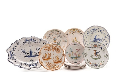 Collection of French faience in the the shape of oval dish and 9 plates decorated in colours with figures, birds and flowers. 20th century. (11)