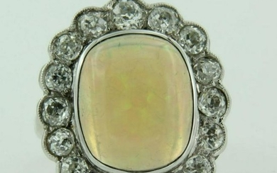 Diamond ring with opal