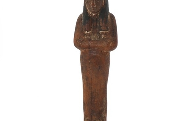 Egyptian wood ushabti with remains of paint. 18th-19th dynasty. H. 21,5 cm.