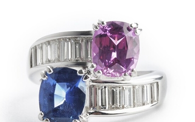 Hartmann's: A sapphire and diamond ring set with an oval-cut pink and blue sapphire and numerous baguette-cut diamonds, mounted in 18k white gold. Size 49.