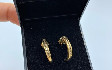 Pair of 9ct yellow gold earrings with 0.3ct diamond inset, w...
