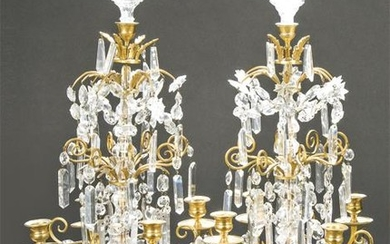 Pair of bronze and crystal candlesticks, France S.XIX.