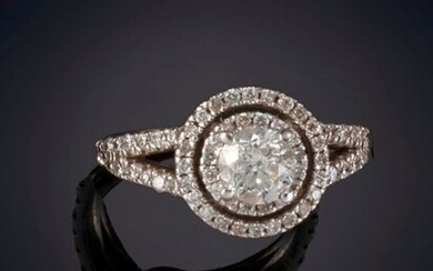 RING WITH A 0.50CT CENTRAL BRIGHTNESS. APPROX. 14k white gold rhinestone setting. Output: 400.00 Euros. (66.554 Ptas.)