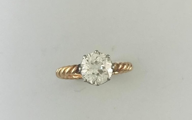 Solitaire twisted ring in gold 750°/°°° and platinum...