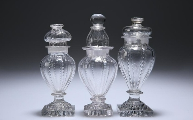 THREE ENGLISH GLASS CONDIMENT BOTTLES AND STOPPERS