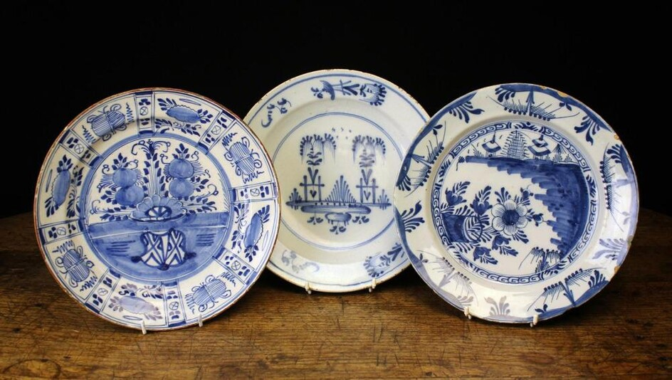 Three 18th Century Blue & White Delft Plates, approximately 12'' (30 cm) in diameter.