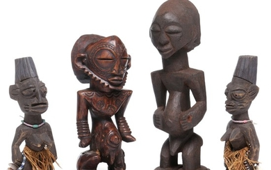 Two ancestor figures and a pair of Ibeji twins of carved patinated wood. Luba and Yoruba style. H. 26–38 cm. (4)