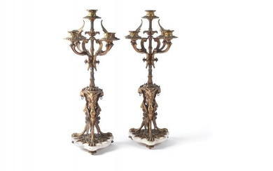A pair of French gilt bronze and white marble mounted five light candelabra, last quarter 19th century