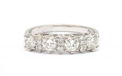 A 14 carat white gold diamond half eternity ring. Featuring four brilliant cut diamonds of ca. 0.75 ct., ca. H-I, VS and in between smaller eight cut diamonds of ca. 0.15 ct. in total. Gross weight: 2.9 g.