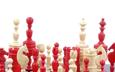 A 19th century natural and red stained bone chess set, King ...