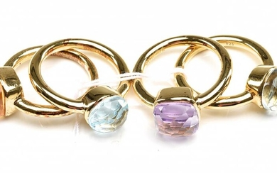 A COLLECTION OF FOUR RINGS IN SILVER GILT, SET WITH AMETHYST, LONDON BLUE TOPAZ, CITRINE, TOURMALINE
