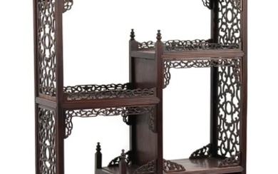 A Chinese carved hongmu display cabinet, of small size, late...
