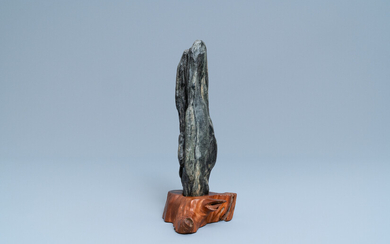 A Chinese scholar's dream stone on wooden stand, 19th C.