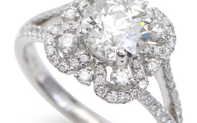 A DIAMOND RING - Featuring an old European cut diamond weighing 1.50cts, within a pierced floral style surround, set with fine diamo...