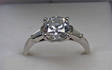 A DIAMOND SOLITAIRE RING, THE BRILLIANT-CUT DIAMOND OF APPROX....