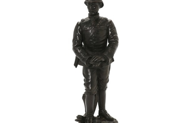 "A French officer, patinated bronze, in a cartouche ""En Campagne!"". Reddish marble base. H. 38/43 cm."