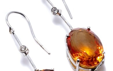 A PAIR OF CITRINE AND DIAMOND EARRINGS; each an approx. 7.7ct oval cut citrine suspended from a line drop set with a round brilliant...