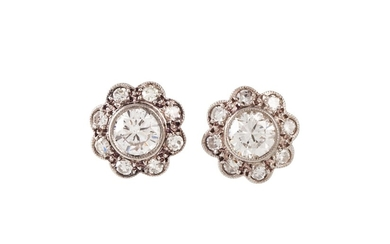 A PAIR OF DIAMOND DAISY CLUSTER EARRINGS, set with circular ...