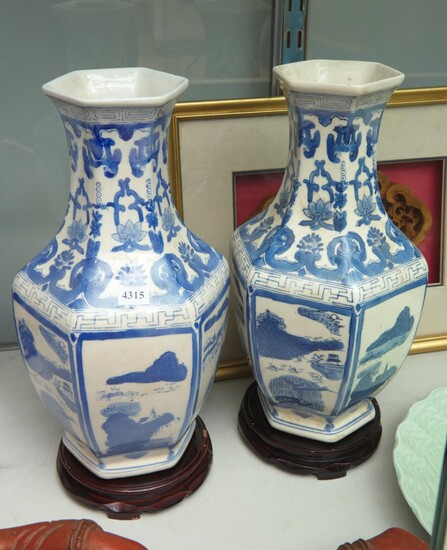 A PAIR OF HEXAGONAL CHINESE BLUE AND WHITE PORCELAIN VASES WITH STANDS