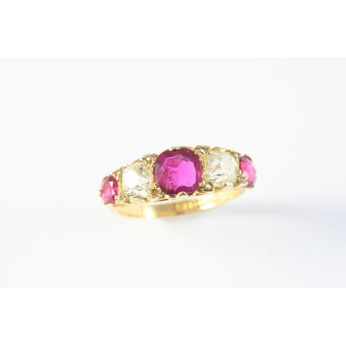 A RUBY AND DIAMOND FIVE STONE RING the three cushion-shaped ...