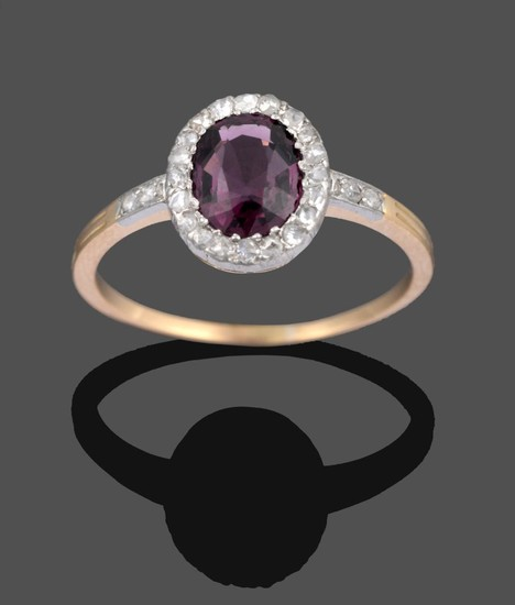 A Spinel and Diamond Cluster Ring, the oval mixed cut...