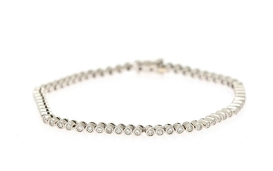 A diamond bracelet set with numerous brilliant-cut diamonds totalling app. 0.80 ct., mounted in 18k white gold. L. 16.3 cm.