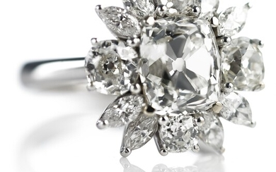 A diamond ring with a cushion-cut diamond weighing app. 3.64 ct. and marquise and old-cut diamonds, totalling app. 6.37 ct., mounted in 18k white gold.