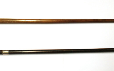 A hallmarked silver mounted walking stick and a further antique walking stick with a marine ivory handle.