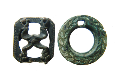 A pair of Roman & Persian bronze inkwell lids
