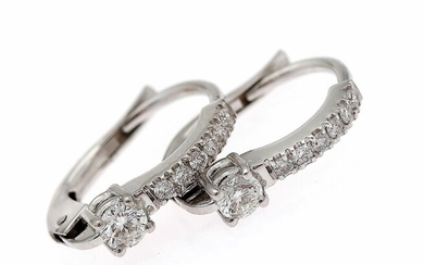 SOLD. A pair of diamond ear pendants each set with numerous diamonds weighing a total...