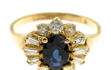 A sapphire and diamond cluster ring.Estimated total diamond...
