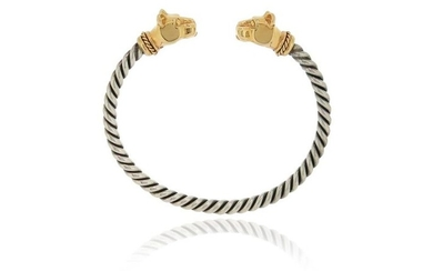 A silver and gold panther's head bangle, with...