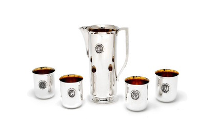 A silver pitcher and four beakers