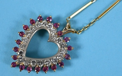 A yellow gold, ruby and diamond heart shaped pendant, on a c...