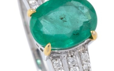 AN EMERALD AND DIAMOND RING; claw set in 10ct white gold with a 1.62ct oval cut emerald above tapering shoulders set with 24 round b...