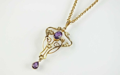 An early 20th century amethyst and seed pearl pendant, designed...