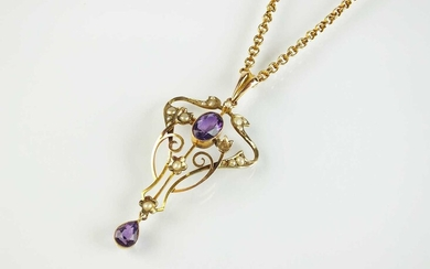 An early 20th century amethyst and seed pearl pendant on chain