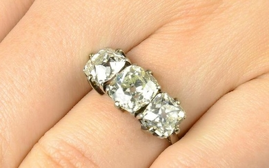 An old-cut diamond three-stone ring. Estimated total