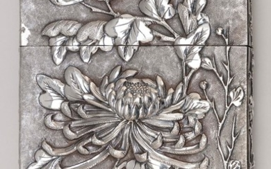 CHINESE SILVER CARD CASE Raised chrysanthemum design on one face and a figural courtyard scene on the other. Blank monogram cartouch...