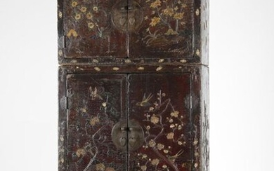 Chinese Art. A rare composite wood lacquered wardrobe (dasijiangui, dingxiang ligui) China, Ming dynasty, early 17th century . An important red lacquered wooden wardrobe with precious and elaborate coral, mother-of-pearl and stones decoration. This...