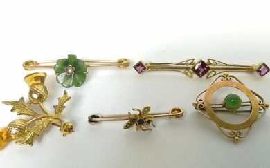 Five gold brooches, some gem set.