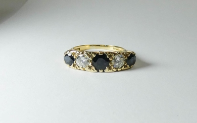 Five stone sapphire and diamond ring, on carved 18ct yellow ...